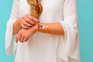 woman wearing personalized bracelets from Love, Georgie