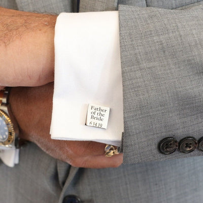 Customer's wedding photo showing Love, Georgie personalized cufflinks engraved