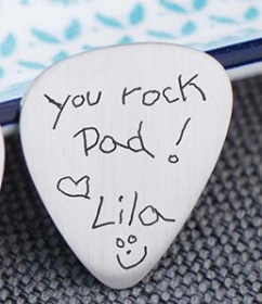 "Child's actual handwriting engraved on a guitar pick. ""You rock Dad!"""