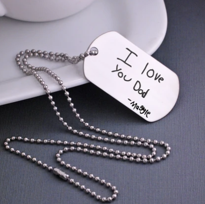 """I love you Dad. Maggie"" engraved in child's actual handwriting on a stainless steel dog tag necklace."