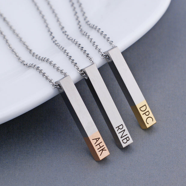 Initials Bar Necklace. Custom engraved with up to three initials. The tip of the stainless steel vertical bar pendant is available in two dipped options (rose gold and yellow gold) in addition to the standard stainless steel. The chain is adjustable and comes in two lengths. Made by Love, Georgie.