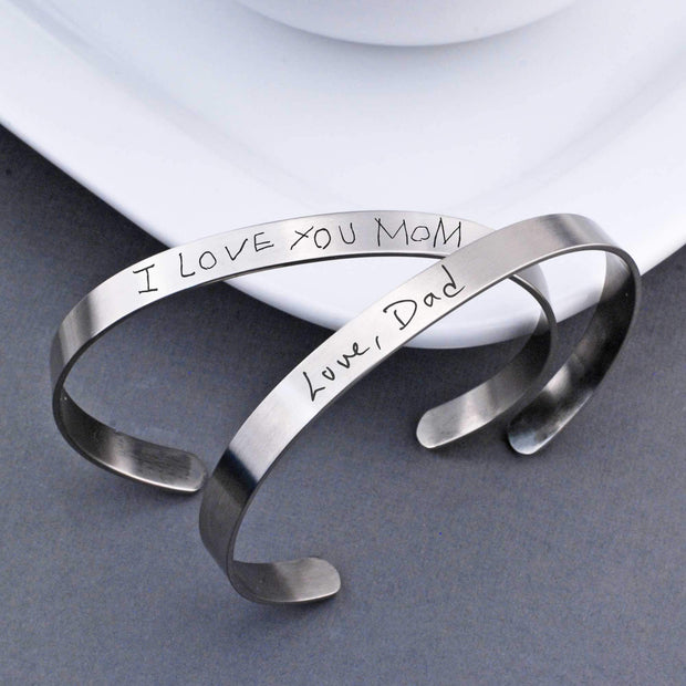 Our Handwriting Cuff Bracelet in stainless steel is adjustable and features your own handwritten phrase or name engraved on outside and/or inside of the cuff. Made by Love, Georgie.