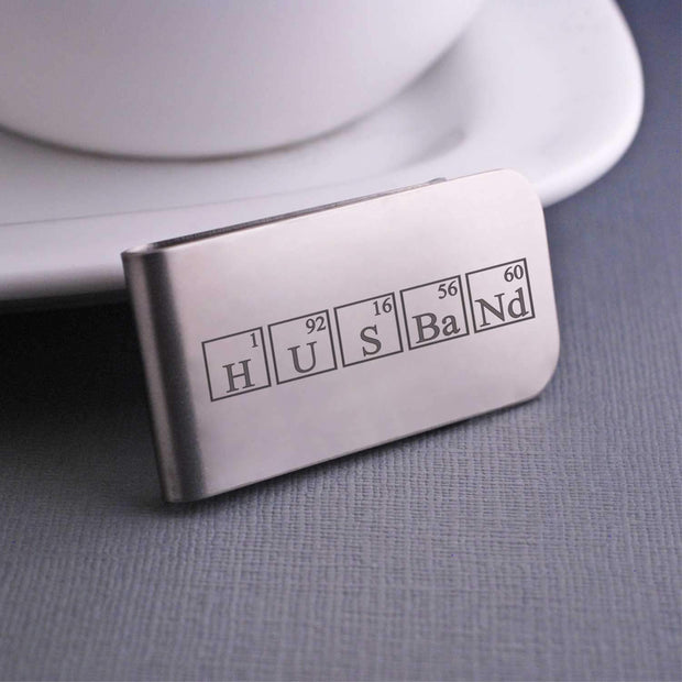 "Husband Periodic Table Money Clip in stainless steel, engraved with  ""Husband"" spelled in periodic table elements"