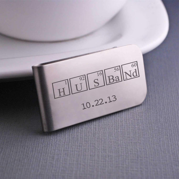 "Husband Periodic Table Money Clip in stainless steel, engraved with date and ""Husband"" spelled in periodic table elements"