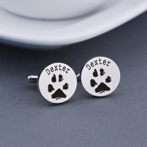 your pets pawprints cufflinks. round. stainless steel. personalized with actual prints and the pets name.