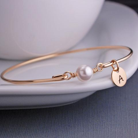 gold and Swarovski pearl bracelet with optional charm