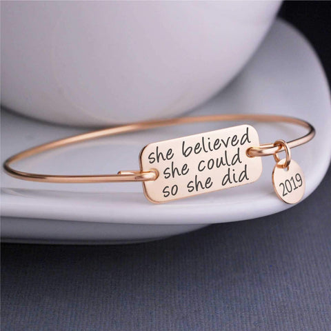 She believe she could so she did. Engraved quote on 14K gold filled bangle bracelet by Love Georgie.