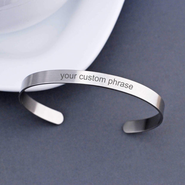 Design your own cuff bracelet. This stainless steel cuff bracelet is custom engraved with your personalized message of up to 50 characters on the outer and inner surfaces.  Made by Love, Georgie.