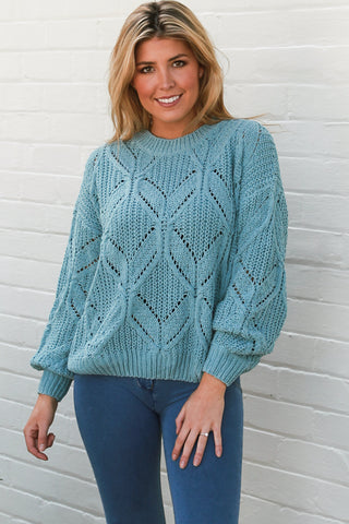 Velour Knitted Sweater. If you've been looking for a cute, snuggly knit sweater for winter then look no further.  The Sasha Velour Knit Sweater is light but warm and features a diamond knit design.  One size fits 10-14. Sits above bottom. From Boho Chic Boutique