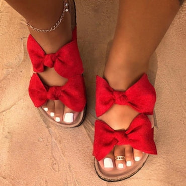 bow decorated solid color sandals