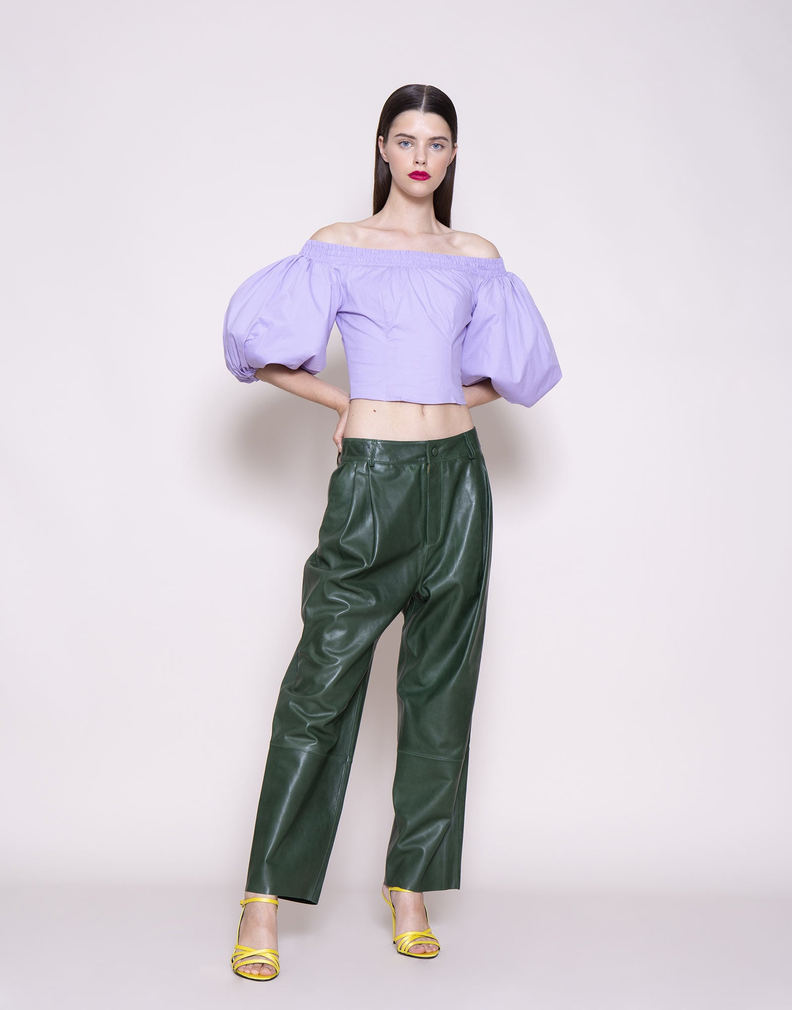 Green leather trousers