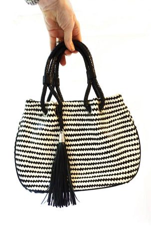 Sasha woven leather black and white tassel handbag
