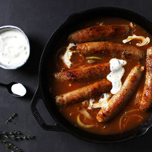 Curried sausages with lemon thyme yogurt dressing