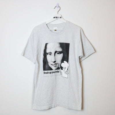 Vintage 90s Mona Lisa Dental Association Tee - L-NEWLIFE Clothing