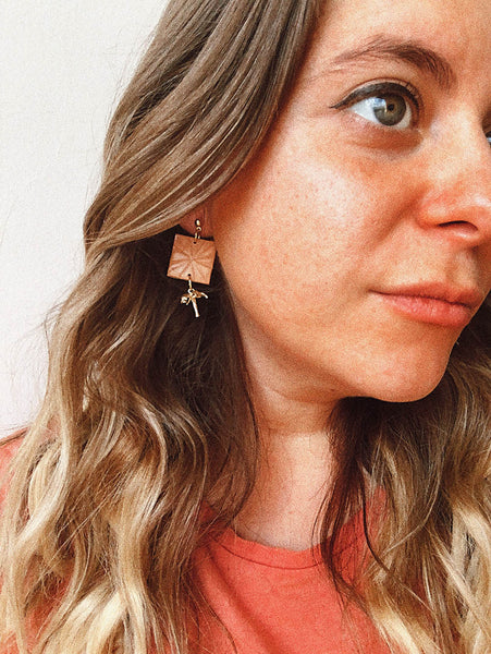 peach matte square earrings with gold palm tree pendant