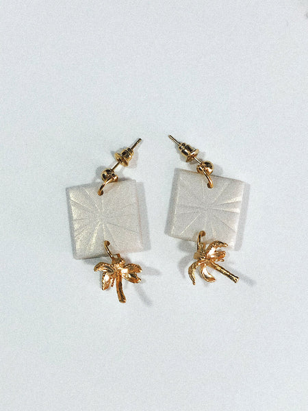 white pearl shimmery square earrings with gold palm tree pendant