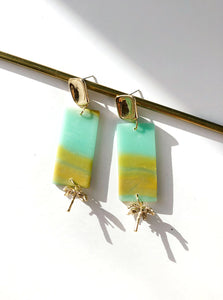 flat lay yellow turquoise green Polymer clay handmade earrings with gold plated silver earring post and palm tree pendant