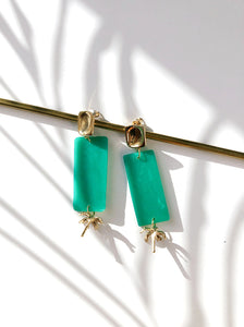 flat lay jade green Polymer clay handmade earrings with gold plated silver earring post and palm tree pendant