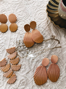 polymer clay handmade earrings in dark orange burnt peach seashell color display and flatlay