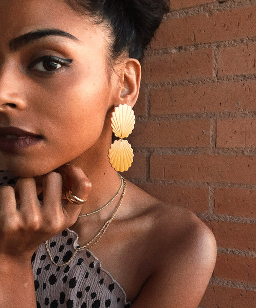 model wearing gradiend matte polymer clay earring