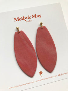 matte pink texture polymer clay earrings with a surf board shape