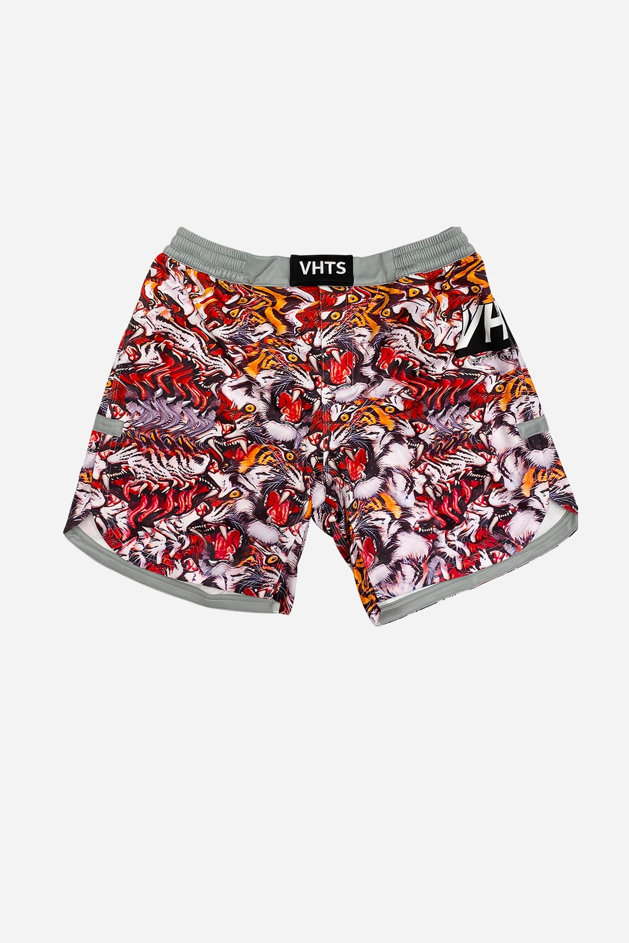 Trippy Tiger combat shorts This shorts is collaborative product between VHTS and graphic artist Voja based in Slovenia.  His creative and embellishing graphic art style is well reflected on the shorts. Tiger themed graphic is eye-catching and visually intense.  Feature  4 way stretch soft fabric (80% polyester x 20% lycra)  Flat draw string with plastic dip tip  Mouth guard pocket  Sublimation printing technique  Curved side opening  Elastic waist band  Velcro closing    vhts europe