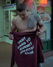 Load image into Gallery viewer, Nick Rodriguez VHTS JJC CHAMPION HODDIE MAROON This product is perfect for on and off the mat. It will keep you warm at the competition and add style on the way for training. CHAMPION S700 FEATURES 9.0 OZ 50/50 Cotton/Polyester Made With Up To 5% Recycled Polyester From Plastic Bottles Two-ply Hood With Dyed-to-match Drawcord Durable Coverstitching Throughout Front Pouch Pocket C Logo On Left Sleeve COLOR Maroon   vhts europe
