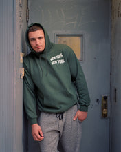 Load image into Gallery viewer, Nick Rodriguez VHTS JJC CHAMPION HOODIE DARK GREEN This product is perfect for on and off the mat. It will keep you warm at the competition and add style on the way for training. CHAMPION S700 FEATURES 9.0 OZ 50/50 Cotton/Polyester Made With Up To 5% Recycled Polyester From Plastic Bottles Two-ply Hood With Dyed-to-match Drawcord Durable Coverstitching Throughout Front Pouch Pocket C Logo On Left Sleeve COLOR Dark Green   vhts europe