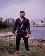 Load image into Gallery viewer, Be Water 3.0 Brazilian Jiu Jitsu Kimono Dark Blue Bjj Dark Blue Gi THIS IS THIRD DESIGN OF BE WATER KIMONO SERIES NEW DESIGN CAME OUT GREAT MAINTAINING ORIGINAL DESIGN CONCEPT YET INTRODUCING MODERN CUT WITH EDGY AND HIGH QUALITY PATCHES AND LABELS. JACKET: 450 GSM PEARL WEAVE EVA FOAM LAPEL WIDE REINFORCEMENT TAPE ROUND SIDE SLIT FINISH RUBBER LABEL PANTS: 11 OZ COTTON RIP STOP 6 BELT LOOP SYSTEM ROUND DRAW STRING RAISED BACK WIDE REINFORCEMENT TAPE RUBBER LABEL vhts europe