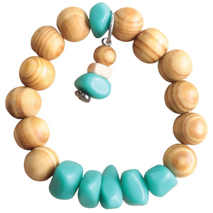 Sandalwood Stretch Bracelet with Turquoise Resin Beads and Charm (Flat View)