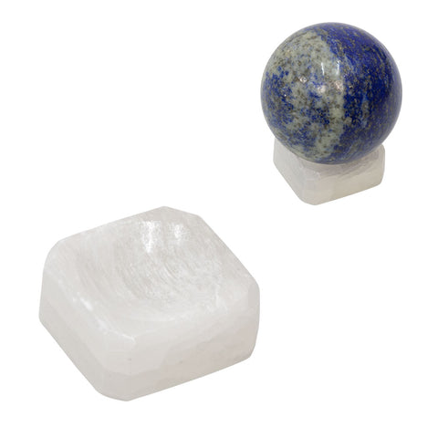 small block of matte white crystal. a blue spherical crystal sits on top