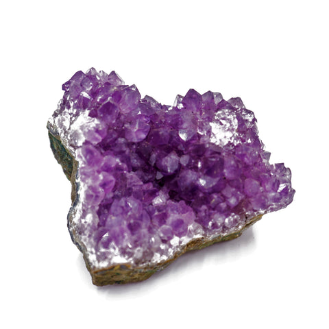 cluster of amethyst crystals on stone base