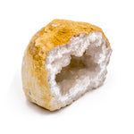 yellow stone cut in half to reveal a white crystal geode