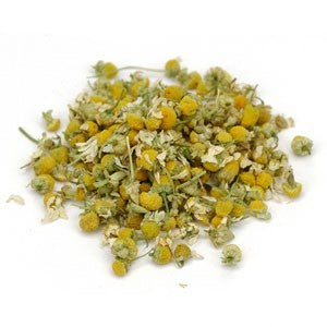 pile of dried chamomile flowers