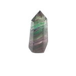 obelisk of purple and green crystal