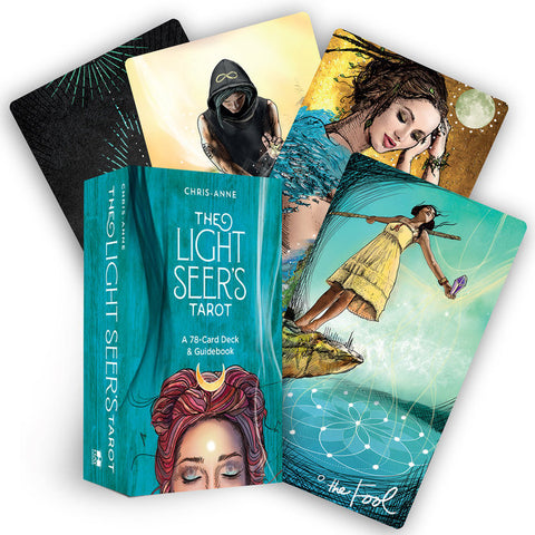 "box labeled ""light seer's tarot."" cards depict a woman about to fall off a cliff into a pool and a smiling woman in dreadlocks"