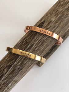 mantra cuff in copper