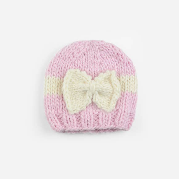 pink knit with cream knit bow