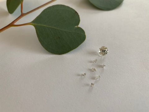 Loose diamonds in various shapes waiting to go into a custom engagement ring
