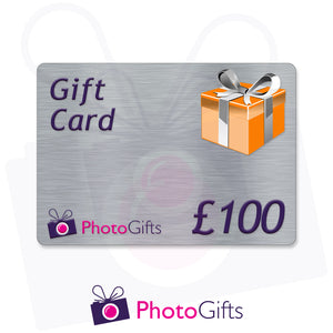 Grey £100 gift card with the writing Gift Card and Photogifts Logo as well as a picture of a gold wrapped box