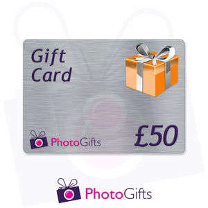 Grey £50 gift card with the writing Gift Card and Photogifts Logo as well as a picture of a gold wrapped box