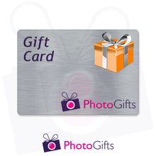Load image into Gallery viewer, Grey card with the writing Gift Card and Photogifts Logo as well as a picture of a gold wrapped box