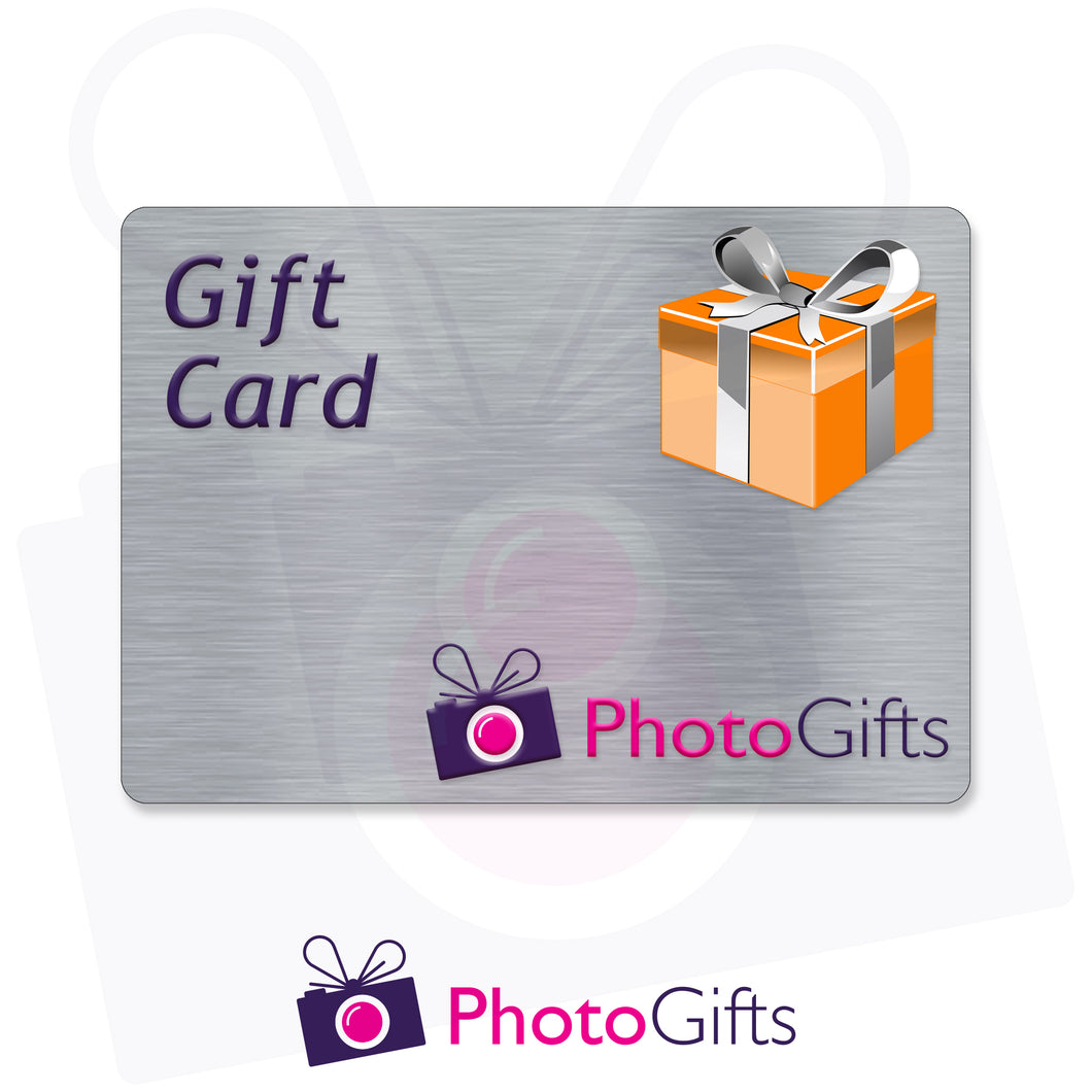 Grey card with the writing Gift Card and Photogifts Logo as well as a picture of a gold wrapped box