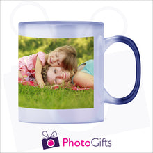 Load image into Gallery viewer, 10oz blue colour change mug that has been personalised with your own choice of image in its fully hot stage as produced by Photogifts.co.uk