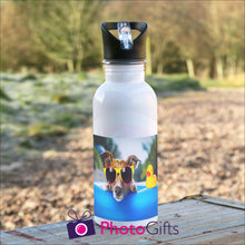 Load image into Gallery viewer, White 600ml sports water bottle on table as supplied by Photogifts.co.uk