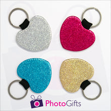 Load image into Gallery viewer, Four glitter heart shaped keyrings. Each keyring is a single coloured glitter in either red, blue, silver or gold. Also shown is the Photogifts logo. Keyring as produced by Photogifts.co.uk