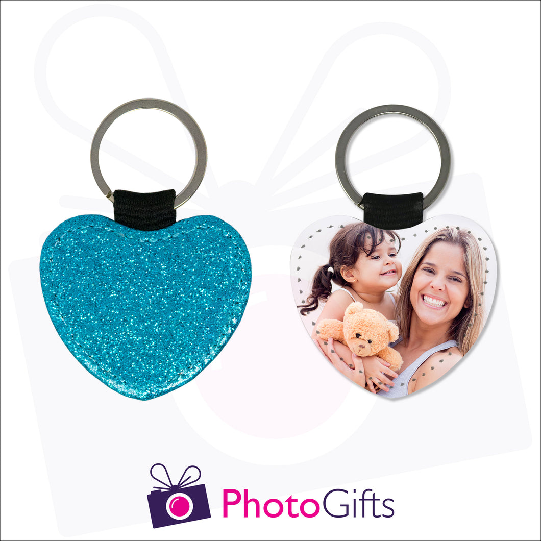 Front and back image of a heart shaped keyring. On one side the heart is all blue glitter and on the other is a photo of a mother holding a toddler and teddy bear in her arms. There is also the Photogifts Logo. Keyring as produced by Photogifts.co.uk