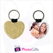 Load image into Gallery viewer, Front and back image of a heart shaped keyring. On one side the heart is all gold glitter and on the other is a photo of a mother holding a toddler and teddy bear in her arms. There is also the Photogifts Logo. Keyring as produced by Photogifts.co.uk