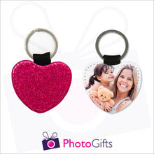 Load image into Gallery viewer, Front and back image of a heart shaped keyring. On one side the heart is all red glitter and on the other is a photo of a mother holding a toddler and teddy bear in her arms. There is also the Photogifts Logo. Keyring as produced by Photogifts.co.uk