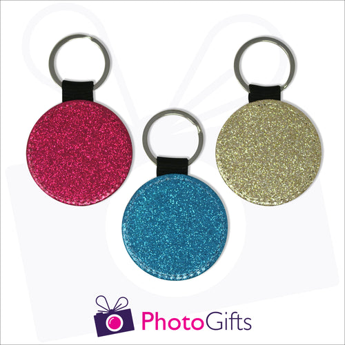 Three glitter round keyrings. Each keyring is a single coloured glitter in either red, blue or gold. Also shown is the Photogifts logo. Keyring as produced by Photogifts.co.uk